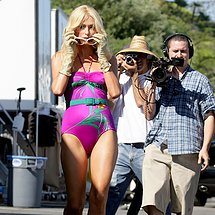 Cameltoe of Paris Hilton in violet swimsuit